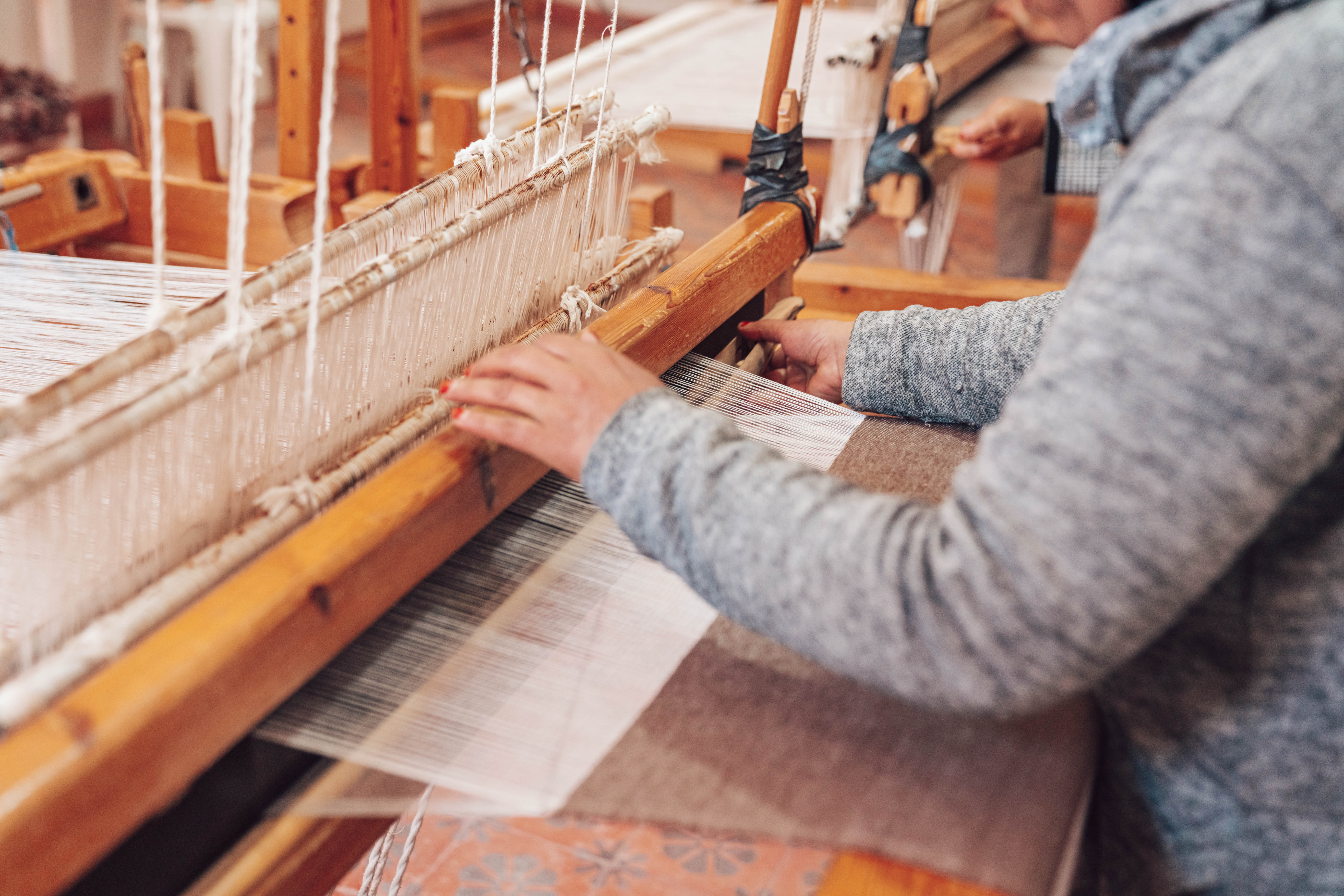 Close up of upright traditional weaving loom
